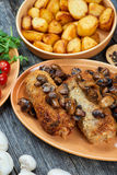 Roulade of pork with roasted mushrooms and potatoes Royalty Free Stock Photos