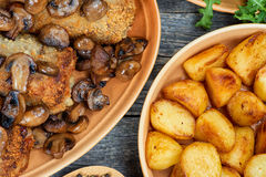 Roulade of pork with roasted mushrooms and potatoes Royalty Free Stock Photography