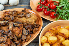 Roulade of pork with roasted mushrooms and potatoes. XXL Stock Images