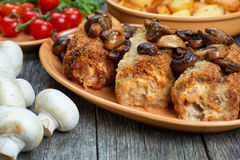 Roulade of pork with roasted mushrooms and potatoes. XXL Royalty Free Stock Images