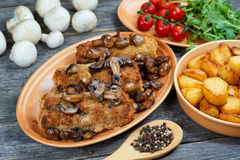 Roulade of pork with roasted mushrooms and potatoes. XXL Royalty Free Stock Photo