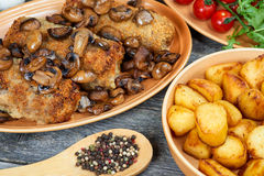 Roulade of pork with roasted mushrooms and potatoes. XXL Royalty Free Stock Image
