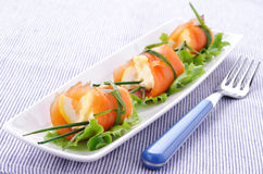 Roulade of smoked salmon on white plate Stock Photography