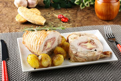 Roulade of stuffed chicken with potatoes. And rosemary on complex background Stock Images