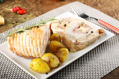Roulade of stuffed chicken with potatoes Royalty Free Stock Photos