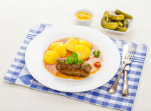 Roulades beef with sauce, mustard and gherkins Royalty Free Stock Images