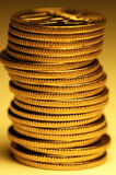 Rouleau. Pile of several golden coins royalty free stock photos