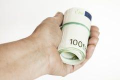 Rouleau de billets de banque dans la main Images libres de droits