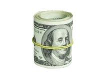 Rouleau de dollars d'isolement sur un fond blanc Photographie stock libre de droits