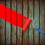 Rouleau de peinture et une vieille barrière en bois Photographie stock
