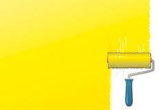 Rouleau de peinture jaune Photos stock