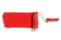Rouleau de peinture rouge Photographie stock