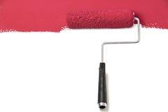 Rouleau de peinture rouge au-dessus de blanc Photographie stock libre de droits
