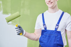 Rouleau de peinture vert photos stock