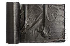 Rouleau de sacs de déchets en plastique d'isolement sur le fond blanc Avec l'espace de copie images libres de droits
