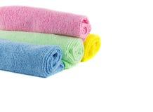 Rouleau de serviettes vertes, bleues, roses et jaunes Photo stock