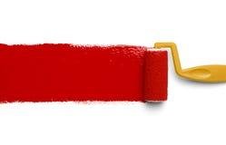 Rouleau rouge de jaune de peinture Photos libres de droits