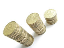 Rouleaues coins. Three rouleau coins consist of many coins close-up Royalty Free Stock Image