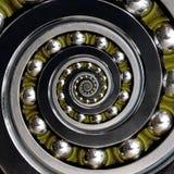 Roulement à billes en spirale dans le sens des aiguilles d'une montre industriel peu commun spécifique de belle cage verte Double images libres de droits