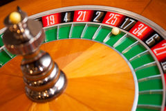 Roulette. Closeup shot of casino roulette  spinning with ball on 17 Royalty Free Stock Photo