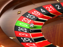Roulette. Wheel with focus on ball and green zero Royalty Free Stock Photos