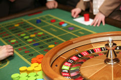 Roulette. Table in casino with people Stock Photography