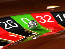 Roulette. With ball on green zero Royalty Free Stock Photography
