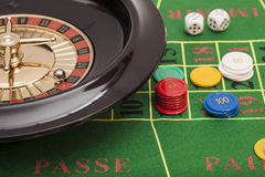 Roulette in casino ,chips and dices stacking on a green felt Royalty Free Stock Photos