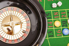 Roulette in casino ,chips and dices stacking. On a green felt royalty free stock image