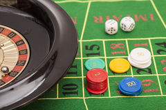 Roulette in casino ,chips and dices stacking on a green felt Stock Photo