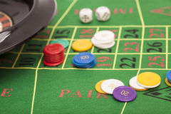 Roulette in casino ,chips and dices stacking on a green felt Stock Images