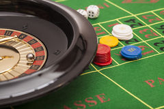Roulette in casino. Chips and dices stacking on a green felt stock photos