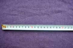 Roulette is 23 centimeters. On a background of purple cloth royalty free stock photo