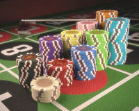 Roulette Chips. Colorful chips on a green table. Depth of field on some chips. Clipping path on the chips Stock Photography