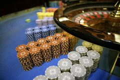 Roulette and chips gambling table.  stock photo
