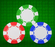 Roulette chips over green textured white Royalty Free Stock Photography