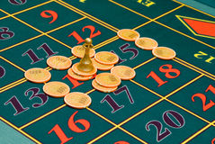 Roulette gambling chips on the table Stock Image