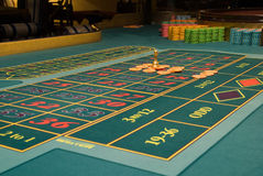 Roulette gambling chips on the table Royalty Free Stock Photography