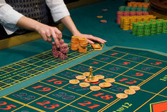 Roulette gambling chips on the table Stock Photos