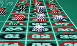 Roulette Game with Chips. Roulette table with multi-colored chips royalty free stock photo