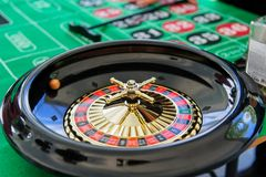 Playing roulette in a casino on a green table royalty free stock photography