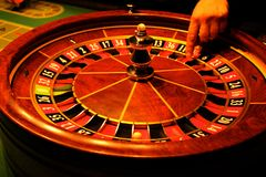 Roulette with hand and the ball Stock Photo