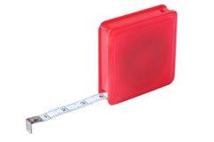 Roulette la medición, herramientas de la construcción, aislante en un backg blanco foto de archivo libre de regalías