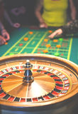 Roulette in motion. Green table with colored chips ready to play. Stock Photography