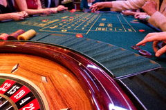 Roulette and players that link Stock Image