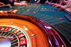 Roulette and players that link Stock Photos