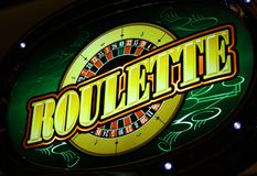 Roulette sign. Yellow roulette neon sign on the green background Royalty Free Stock Photos