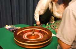 Roulette table. And people in casino Stock Image