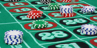 Roulette Table. With multi-colored chips royalty free stock photo