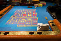 Roulette table in the casino stock photos